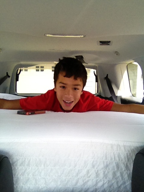 Mattress surfing in the back of our ride!